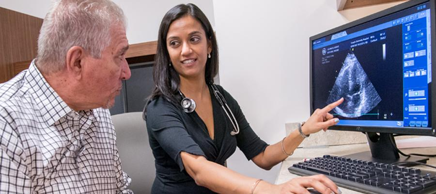Anjali Vaidya going over results with CTEPH patient