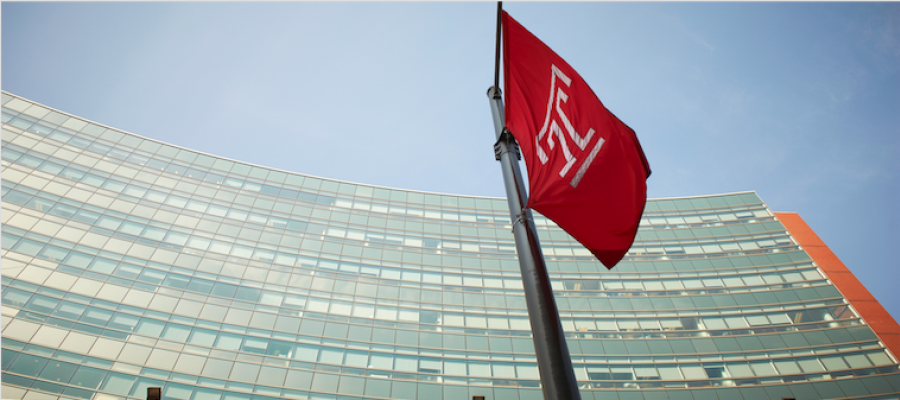 Temple flag in front of Temple University Medical Education and Research Building