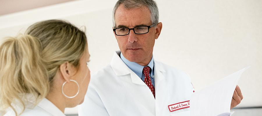 Doctor consults with colleague