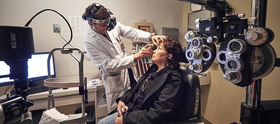 Ophthalmologist performs eye treatment