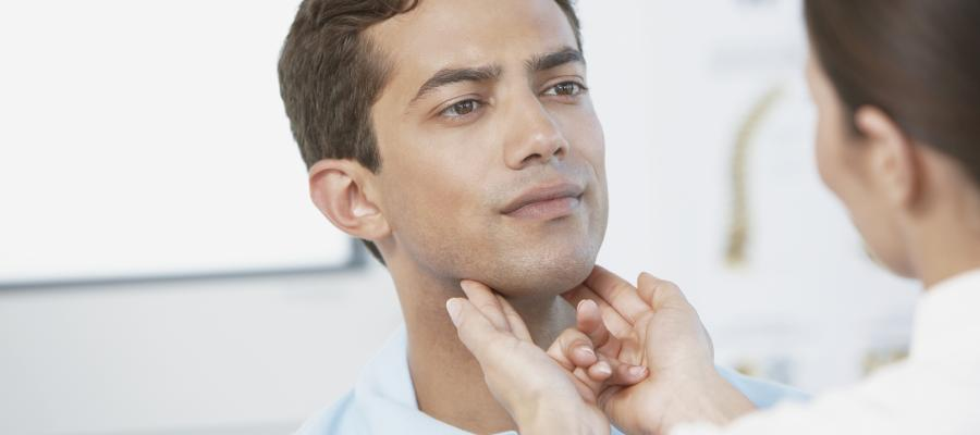 Physician looking at patients throat
