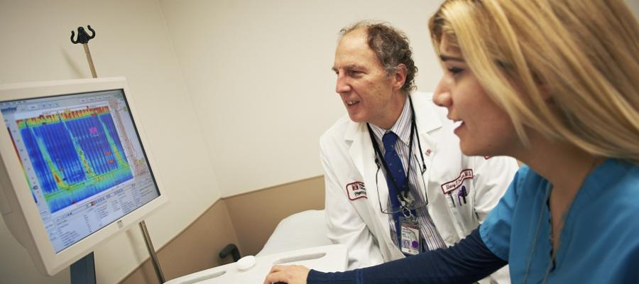 Physician with nurse reviewing data