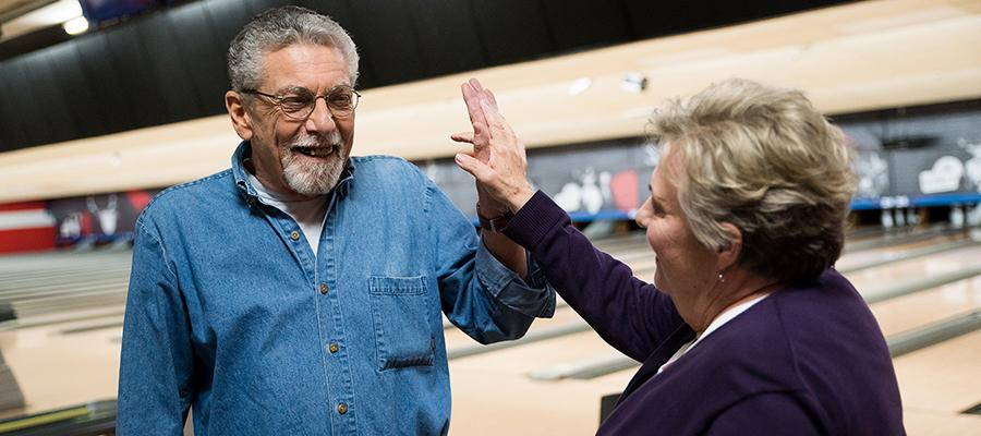 Temple COPD patient, John, bowling with his wife