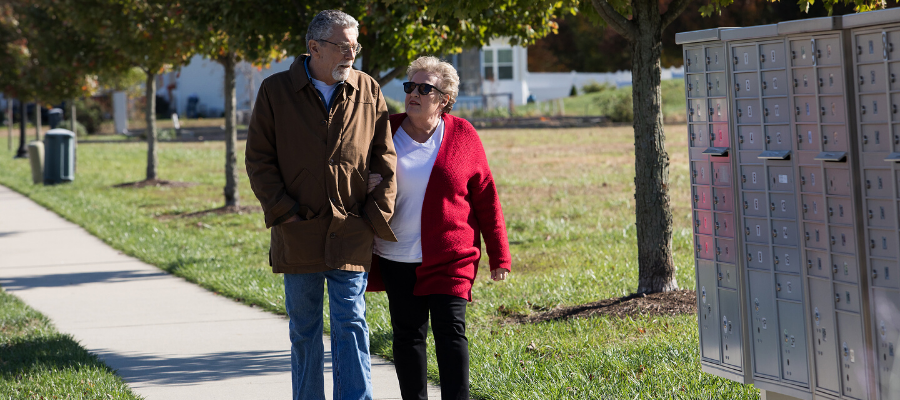 Temple Health COPD patient, John, walking with his wife to their mailbox