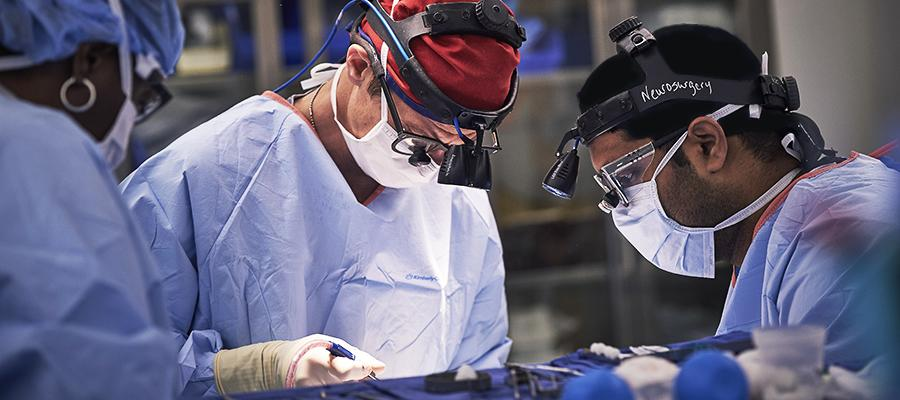 Three neurosurgeons in operating room