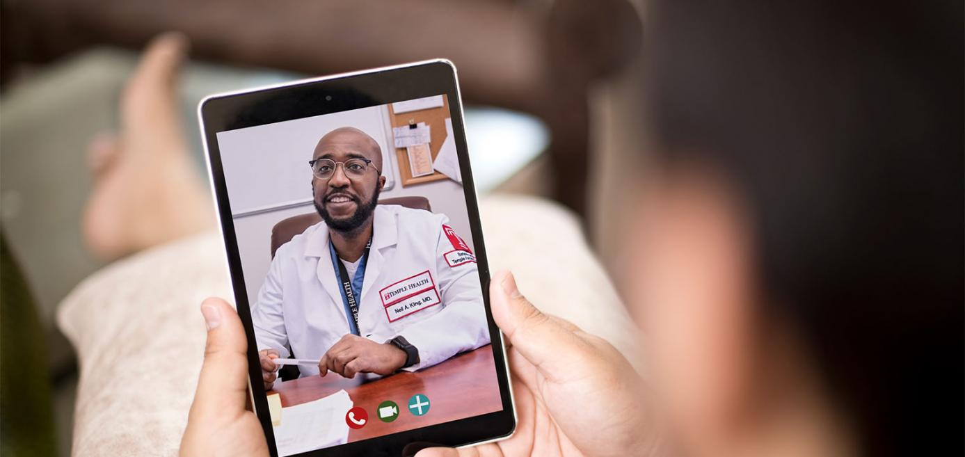 Patient having telemedicine appointment with Dr. Neil King