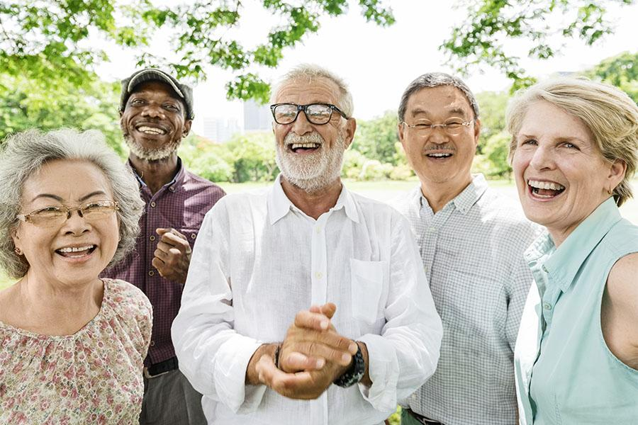 Group of multi-ethnic people smiling in park