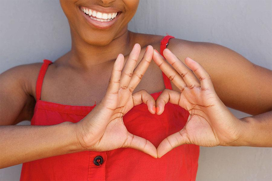 Women making a heart shape with her hands