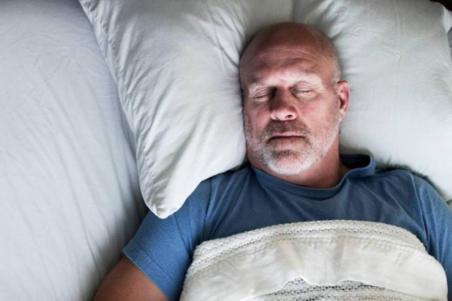 Closeup of man sleeping in bed