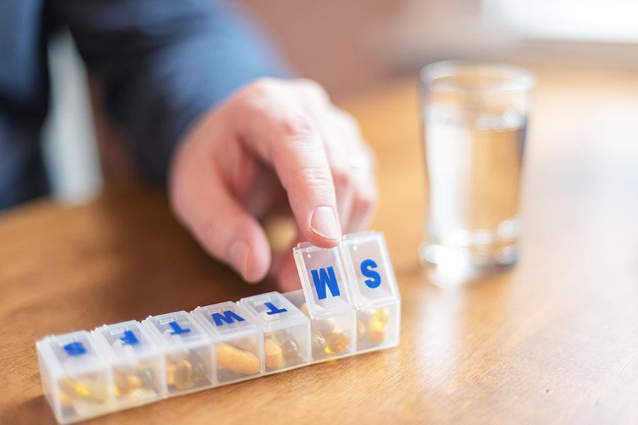 Closeup of blood pressure pills in pill organizer