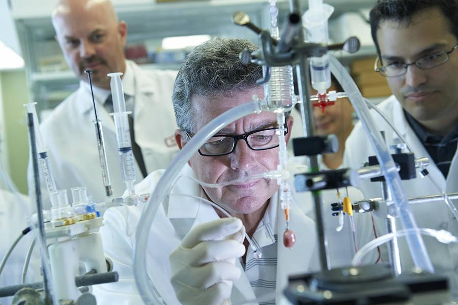 Dr. Steven Houser conducting research in lab