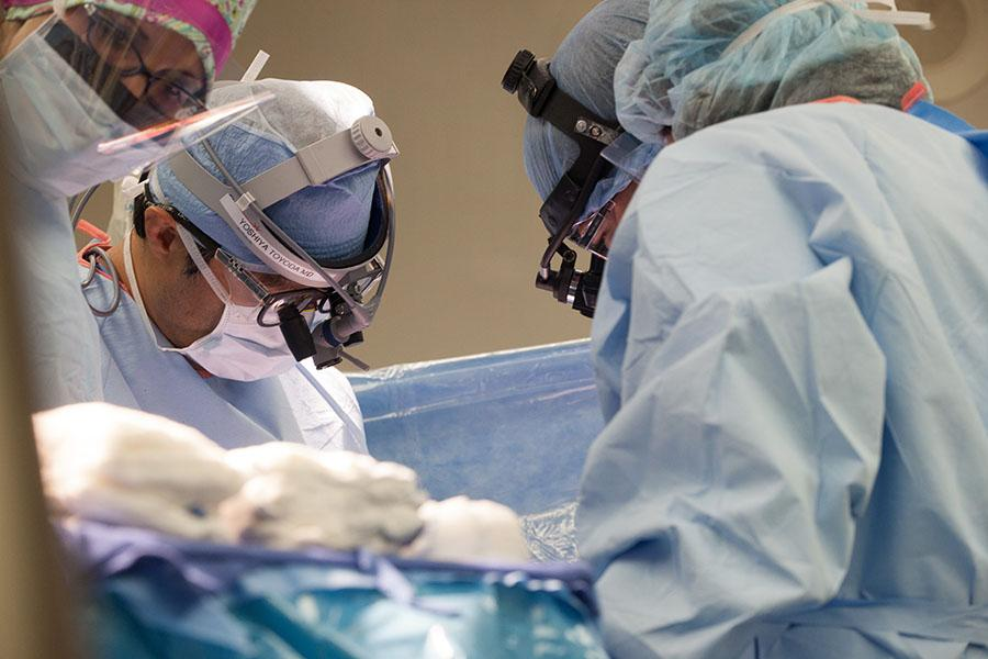 Dr. Yoshiya Toyoda performing heart transplant surgery