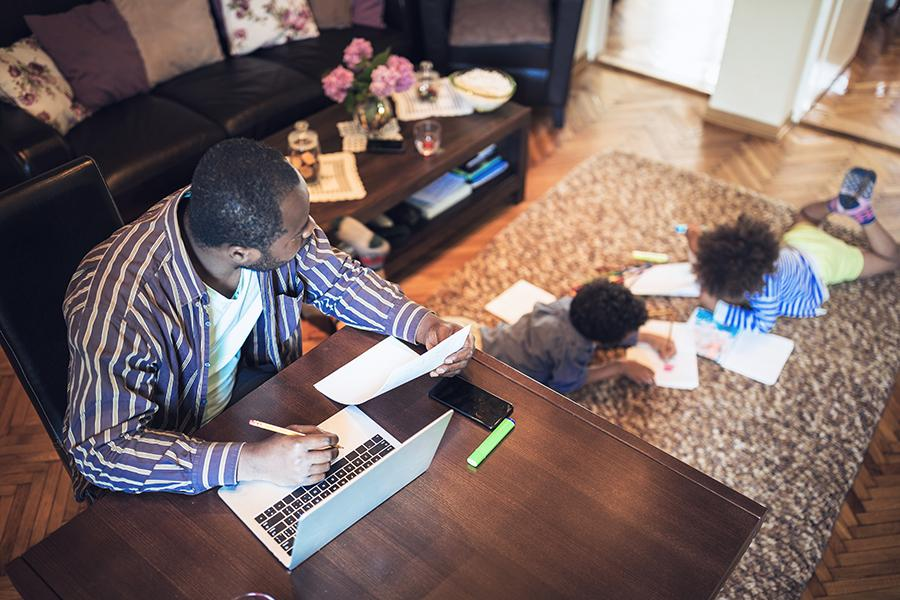Father working from home on his laptop