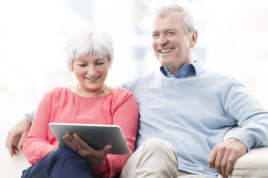 Husband and wife review patient portal on tablet