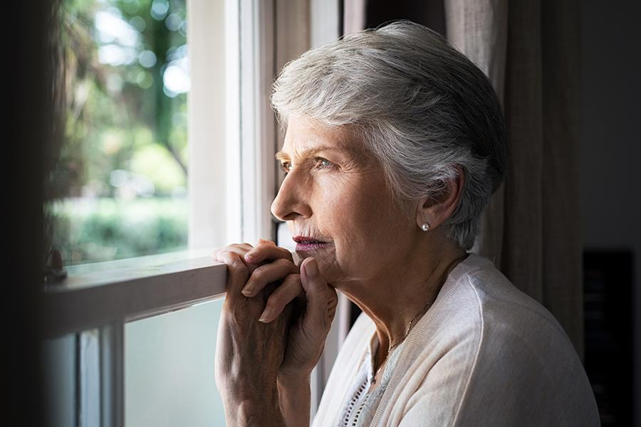 Older woman looking out the window