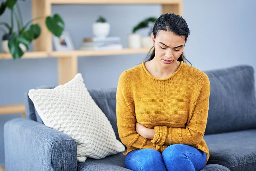 Woman feeling bloating in her stomach