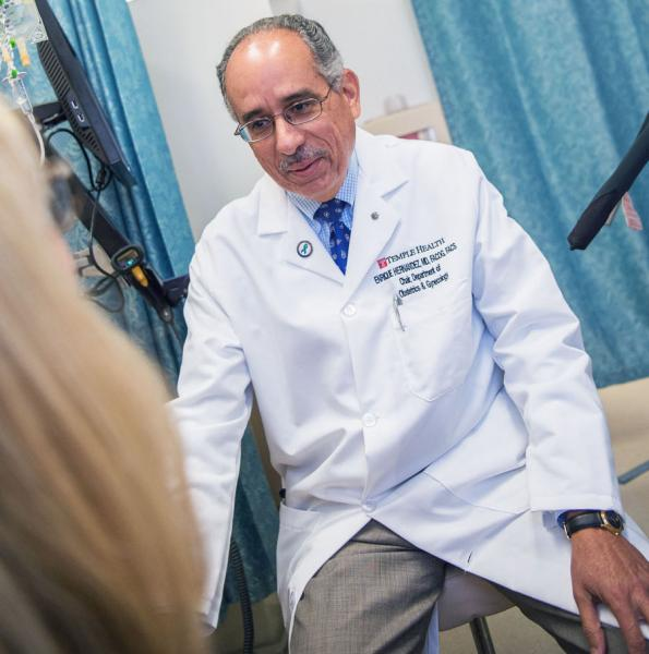 Dr. Hernandez consults with OB-GYN patient