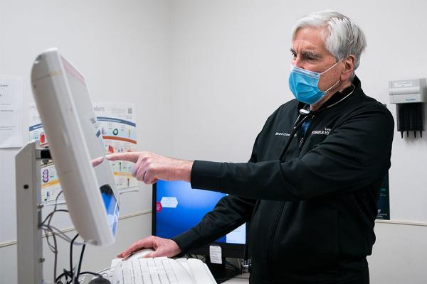 Dr. Gerard Criner looking at a COPD patient's medical record on screen
