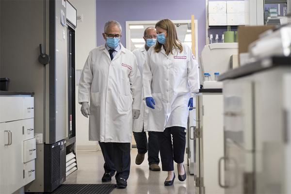 Temple HIV researchers walking through their lab
