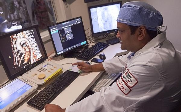 Temple cardiologist looking at x ray on computer