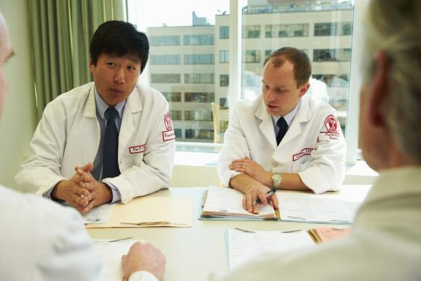 Temple physicians at a meeting having a discussion