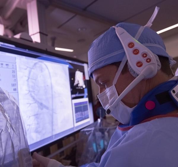 Closeup of cardiologist examining screen during procedure
