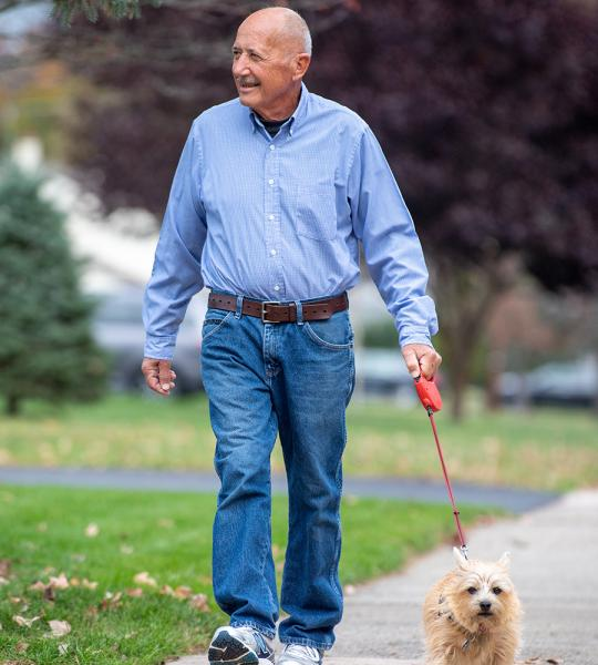 Heart transplant patient, Heinz, walking his dog