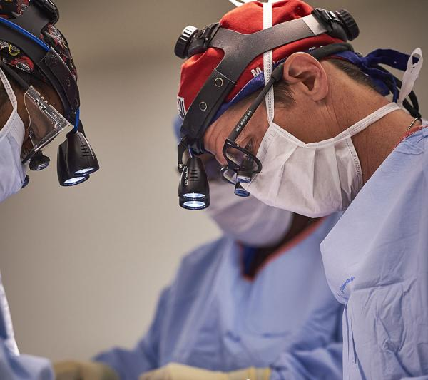 Dr. Michael Weaver treating severe traumatic brain injury patient