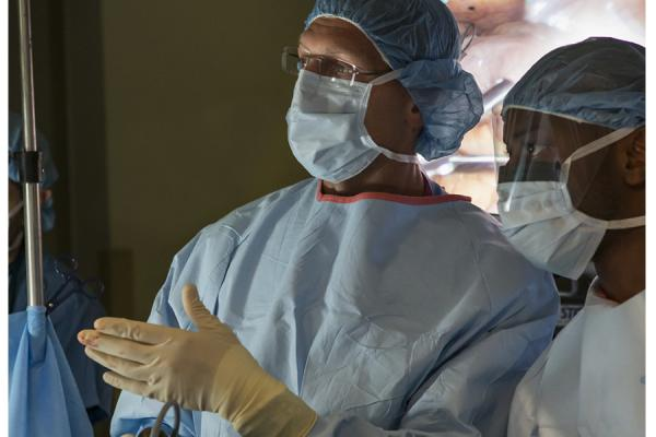 Surgeon instructing colleague during surgery